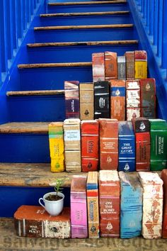 Bricks painted to look like books in the garden.