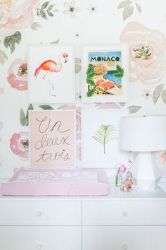 Floral fun wallpaper, great gallery art. It all goes together so well in this stunning pink and girly nursery.