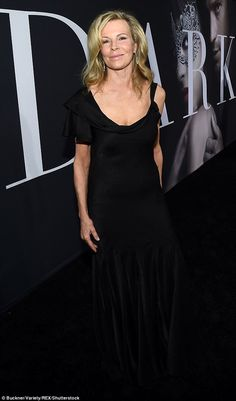 She's back! Kim Basinger, 63, looked sensational in a low-cut black gown as she arrived at the premiere for Fifty Shades Darker in Los Angeles