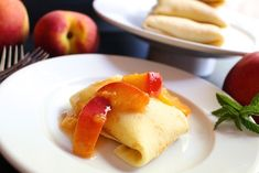 Hot Buttered Peach Blintzes ~ I have had a long love affair with peaches. They are on top of my list for best foods to consume while stranded on a deserted