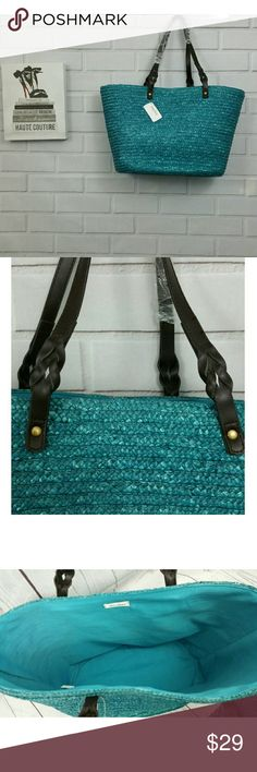 NWT: Neimen Marcus Turquoise Straw Bag This cute bag has a great base to stand on its own and pretty brown straps that are braided at the base.   Generous opening throwing in anything from books to toys to extra things you need for your day.   18 in across 11 Tall 10 in strap drop Neiman Marcus Bags Totes