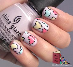 patchwork hearts nails -  hearts in pink,  mint, and yellow over lilac (purple) nail art design
