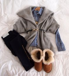 Blue gingham shirt, grey sweater, black skinnies and Uggs
