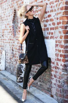 Savvy in black. Black vest. Black skinnies