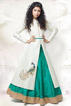 Dress up your little diva in a plush Banglori Silk,Silk Lehenga Suit White colour of the Lehenga Suit looks charming and pretty. This Lehenga Suit will make your dear little angel look adorable for an...