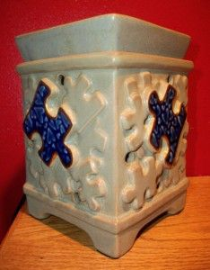 I have this in my house I LOVE IT !!!    Scentsy Piece by Piece warmer raised over $500,000 for Autism Speaks totally love this company and my warmer