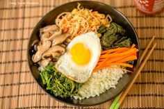 This amazing Korean Cauliflower Bibimbap recipe is delicious, low-carb, keto friendly, and easy to make. The perfect quick vegetarian weeknight dinner idea.