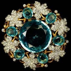 Trifari 'Alfred Philippe' Gold Pave Leaves and Giant Aquamarine Stone Circular Floral Swirl Pin