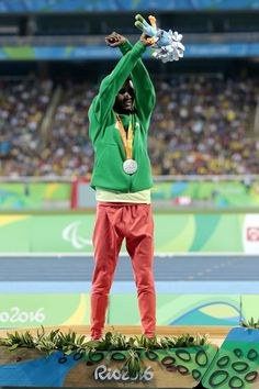 Silver medalist Tamiru Demisse of Ethiopia celebrate on the podium at the medal ceremony for the Men's 1500m - T13 Final during day 4 of the Rio 2016 Paralympic Games at the Olympic Stadium on September 11, 2016 in Rio de Janeiro, Brazil.