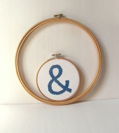 """This gave me an idea (which I'm sure has probably been done before): Cross stitch 3 hoops...One that says """"you"""", one with an """"&"""" symbol, and one that says """"me"""" and hang in the bedroom."""