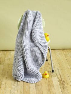 This easy to knit Cuddle Tight Baby Blanket is perfect for beginners. Knit in garter stitch on the diagonal, it only looks complicated. And, because it's knit in Wool-Ease Thick & Quick, it will be done before you know it. Make it for a baby boy in Glacier, shown, or for a baby girl in Blossom.