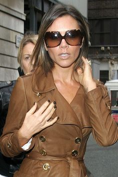 Pin for Later: Victoria Beckham's 45 Most Fabulous Moments in a Pair of Sunglasses A Tortoise Rim to Complement the Brown Shade of Her Trench