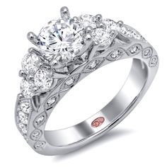 Designer Engagement Rings from DemarcoJewelry.com    Available in White or Yellow Gold 18KT and Platinum. 1.13 RD  Capture her grace and endless beauty with this confident yet elegant design. We have also incorporated a unique pink diamond with every single one of our rings, symbolizing that hidden, unspoken emotion and feeling one carries in their heart about their significant other.  This is not just another ring, this is a heirloom piece of jewelry.