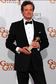 """Colin Firth poses with his award for Best Performance by an Actor in a Motion Picture - Drama for """"The King's Speech"""""""
