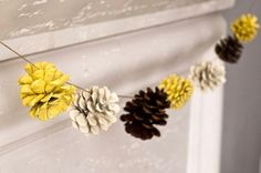 Painted pinecone garland- I'd personally do it in green, white, and gold, but that's personal preference. (: