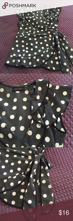 Black and white polka dot blouse Cute black and white polka dot blouse! V neck and side tie with ruffle cap sleeve! Looks adorable on black skinny trousers! In great condition!!!! Axcess Tops Blouses