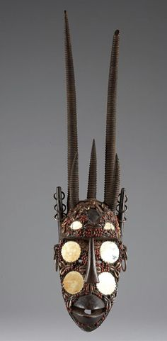 Africa | 'Ci-wara-ni kun' mask from the Bozo people of Kita region of Mali | Wood, cowrie shells, abrus seeds, mirrors, metal | ca. 1931