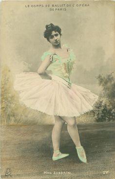 """Ballerina ~ Mme. Sandrini.  """"Le Corps de Ballet de l'Opera de Paris.  Hand-colored photograph ~ 1904."""