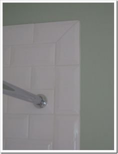 'picture framed' subway tile with mitered corners. Carriage House in Yarrow, Int by Maria Killam