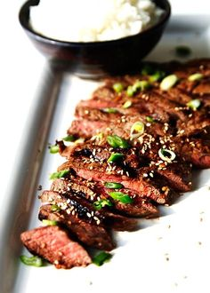 The Pioneer Woman's Flank Steak    Ingredients        1/2 cup Soy Sauce      1/2 cup Sherry      1/4 cup Honey      2 Tablespoons Sesame Oil      2 Tablespoons (heaping) Minced Ginger      2 Tablespoons (3-5 cloves) Minced Garlic      teaspoons Crushed Red Pepper Flakes      2 Flat Iron Steaks      Garnish: 2 Tablespoons Roasted Sesame Seeds and 2