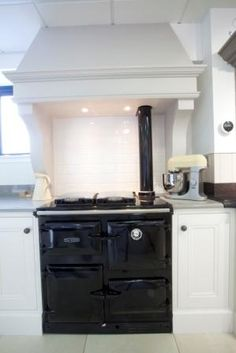 Extractor like this for our kitchen, doesn't take up too much worktop space