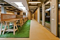 Interesting concept of using artificial grass indoors….its possible to even use picnic tables as desks…definitely would make people freak at the uniqueness...