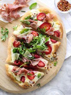 Homemade flatbread pizza with berries, arugula and prosciutto
