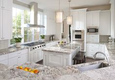 Traditional Kitchen with Limestone Tile, Antico Cream Granite, Tibetan Barstool, High ceiling, Crown molding, Pendant Light