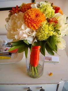 i designed this wedding bouquet using white fluffy peonies, locally grown orange dahlias and mini green hydrangea for a very vibrant bride who oozed with an upbeat personality.