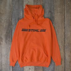 952d71e4b59 STIHL Orange Hooded Sweatshirt Wood Cutting