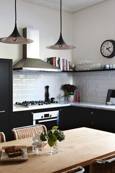 Kitchen Design--Tour A Victorian Stunner with Approachable Style// subway tile, modern pendants, eat-in kitchen. Kitchen World, Eat In Kitchen, Kitchen Dining, Kitchen Decor, Kitchen Ideas, Kitchen White, Kitchen Pulls, Kitchen Modern, Black Kitchens