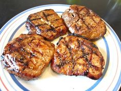 Marinated Pork Chops- A simple marinade makes for yummy tender pork chops! Perfect for Memorial Day weekend grilling!