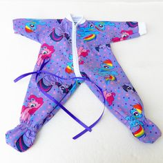A touch of whimsy is in this darling print. I am not associated with this company in any way. Includes:  - Purple My Little Pony print zip up
