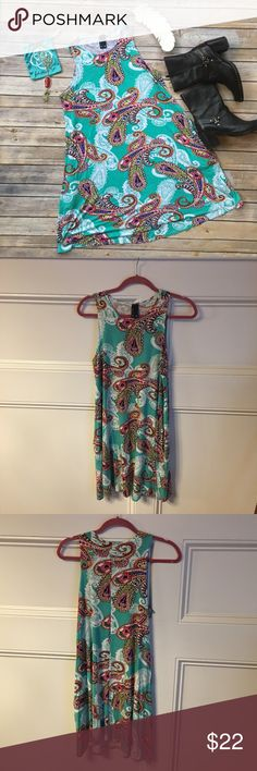 🎉🎉HP🎉🎉 Boho Casual Sleeveless Swing Dress Great quality piece with bright color palate. Hits at the knee. Flowy and fun. Side pockets. Excellent condition. solo la fe Dresses