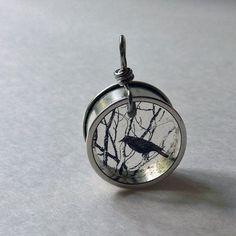 black crow on branch / raven resin pendant / silver by beadingmom