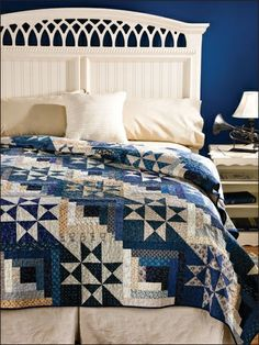 Blue and white quilt on a bed