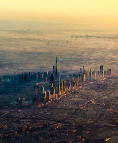 This image of Dubai's skyscrapers was taken from a plane arriving at the city's airport. Future Travel, Skyscrapers, Historical Sites, Natural Wonders, Aerial View, Yachts, The Places Youll Go, National Geographic, Airplanes