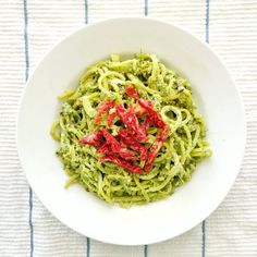 Spiralized golden beet noodles with parsley walnut pesto, sun-dried tomatoes, and hemp seeds. Vegan and paleo. Ready in 20 minutes!