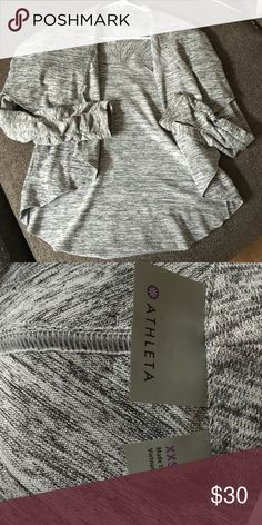 Athleta sweater jacket/cardigan Speckled grey athletic cardigan. Thumb holes. Rutched detail on sleeves. The top/shoulder part has extra fabric to fold over. Super cute and comfy but just doesn't fit me anymore 😭 even though it says it's an XXS I think it fits more like a XS or S Athleta Jackets & Coats