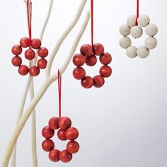 Scandinavian Christmas ornaments from wooden beads -- maybe make your own with cranberries