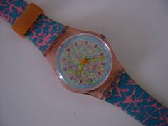swatch watch- mine was exactly like this but pink and black, i <3 it