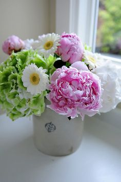 vintage container with amazing flowers