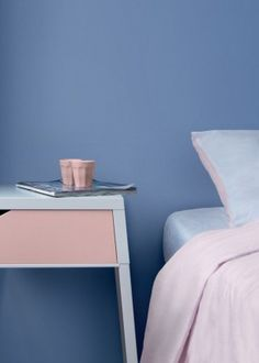 We've put together a colorful moodboard with the new Pantone colors Rose Quartz (soft pink) and Serenity (lavender) - Roomed