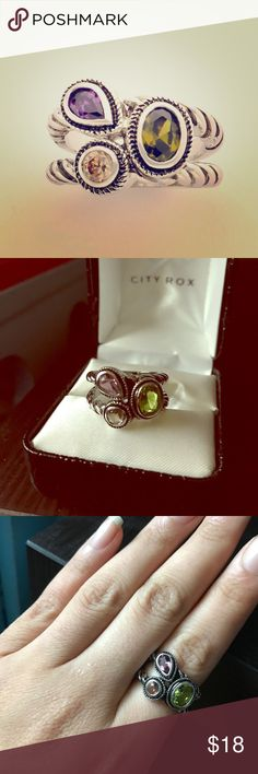 City Rox Cable Wrap Ring Cluster Gemstone Ring (7) New in box City Rox brand cable wrap cluster ring in size 7.  This silver tone ring has a trendy twisted double strand band with three cluster of multi-faceted gemstones, one purple, one green and one white.  Included black box in photo. Jewelry Rings