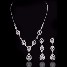 A classic styled wedding jewelry set, perfect for any bride! Pave surround teardrops hang from similar oval jewels. This necklace is 15.25 inches long with a 2