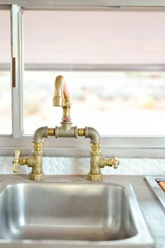 This is a sink in a renovation of an old trailer--love the gold/bronze/silver combo. I think this would work in the Bee Kitchen...it's hard working and industrious, you know, like bees...