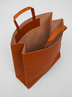 "Antiatoms has released an extremely interesting collection of leather goods called ""Paper Containers."" The collection consists of 4 pieces that resemble common paper containers such as a brown paper bag, a lunch bag, and envelopes, but all are made of leather. The envelope style pieces are for your iPad and 15″ Macbook case, while the …"