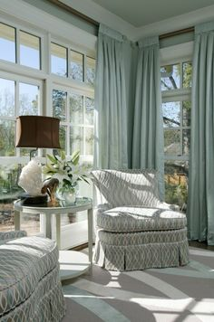 Lovely Living room, seating area with gorgeous windows & drapery panels - rug- turquoise | white | brown