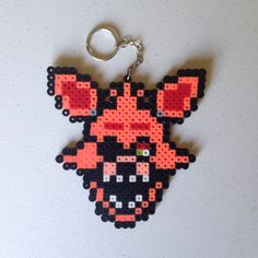 Foxy the Pirate Fox, from the hit video game series Five Nights at Freddy's (FNAF) made from Perler Beads. Inspired by Retr8bit on DeviantArt (http://retr8bit.deviantart.com/art/Five-Nights-At-Freddy-s-Animatronics-Set-1-514146186)