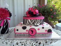 Zebra and Polka Dots Baby Shower Cake - Wish you could see the inside.  The cake itself was black and white Zebra print.  The decorations are all mmf.  The bottom ribbon is hand painted.